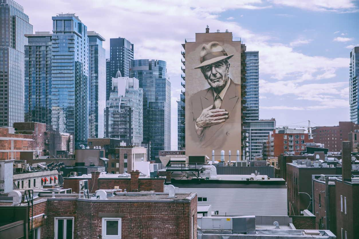 Montreal's skyline with the downtown skyscrapers and the Leonard Cohen homage mural